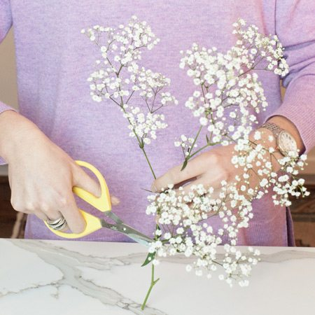 Tips on arranging your roses: Trim your fill flowers (such as baby's breath, tree fern, wax flower, or limonium) and tuck them into your arrangement where you see gaps. Your fill flowers should be lower and deeper in the arrangement than your roses.