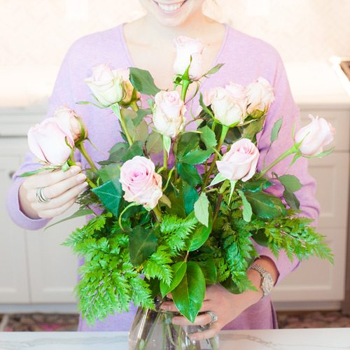 Tips on arranging your roses: Measure and cut the remaining six roses to be shorter than the center and middle roses. Again, trimming one at a time. Place your roses between the existing roses, toward the outside edge of your vase.