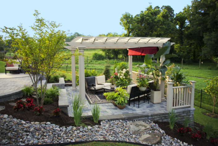 White Pergola, Stone Patio, Rock Drainage Area