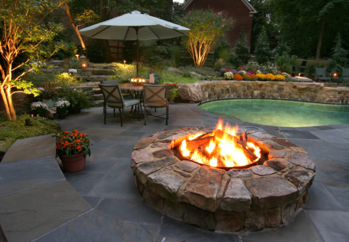 Poolside Fire Pit, slate patio, stone fire pit, stone wall