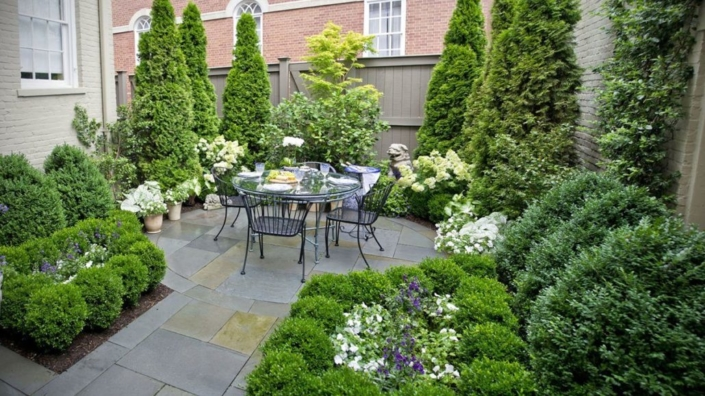 Round Patio with Evergreen Plantings