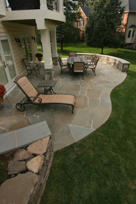 Natural Slate Patio with Stone Wall