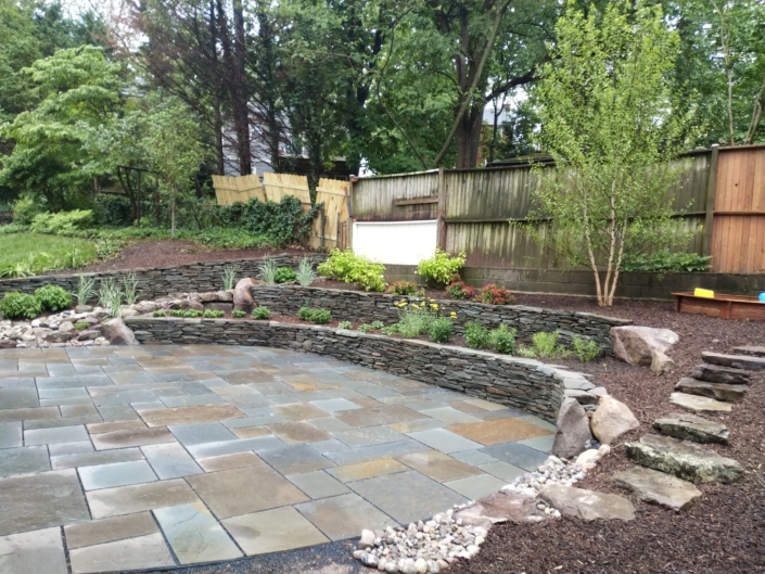 Slate Patio and Terraced Rain Garden, Stone Wall, Drainage Solutions