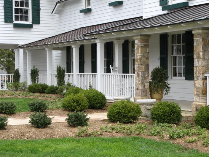 White Home, Evergreen Plantings, stone columns, porch