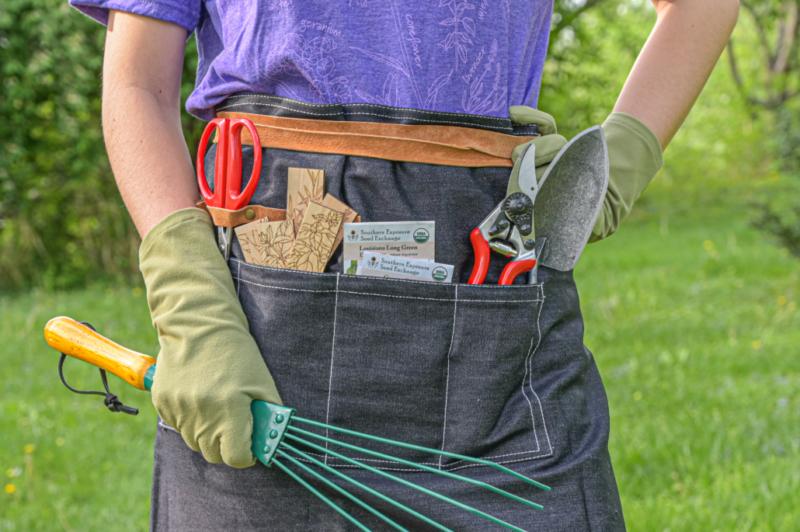 Garden tools, pruners, scissors, rake, seeds, tool apron