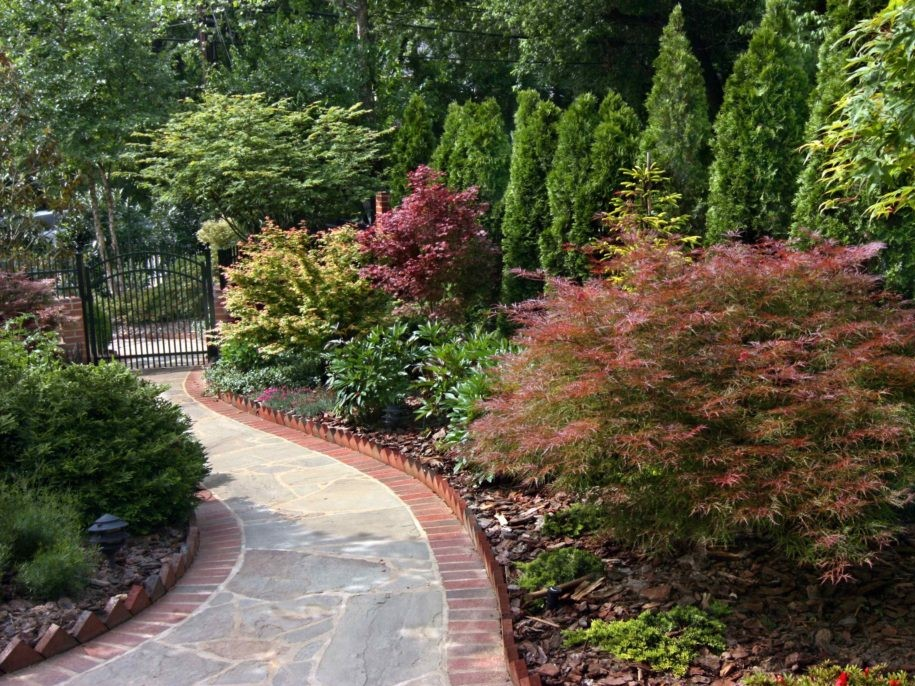 Brick and Stone Path with Evergreen Plantings