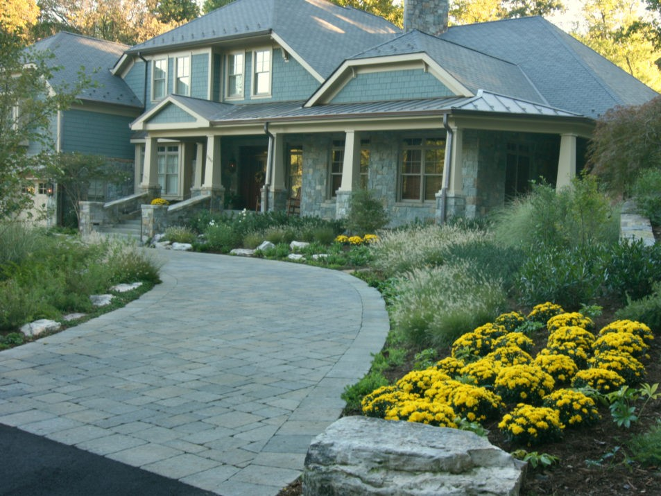 Stone Driveway with Perennial Foundation Plantings and Ornamental grasses