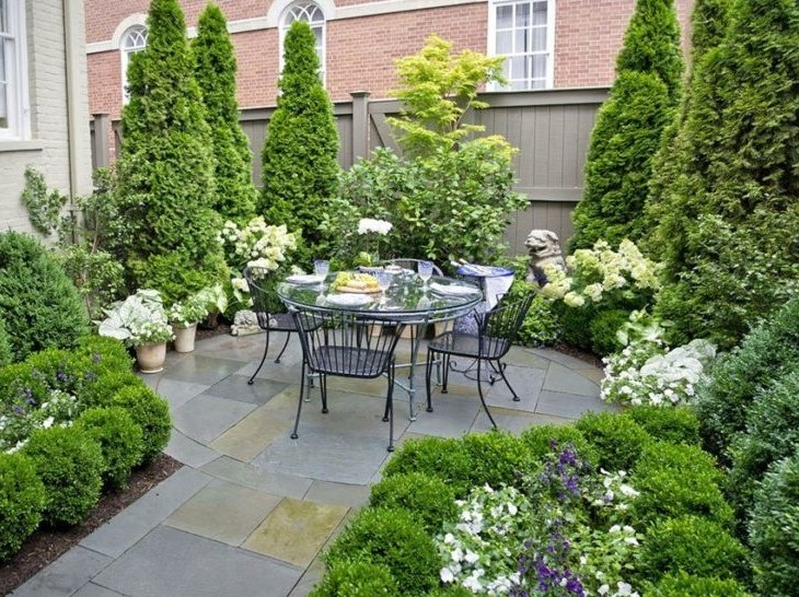 Townhome Slate Patio with Screening Evergreens