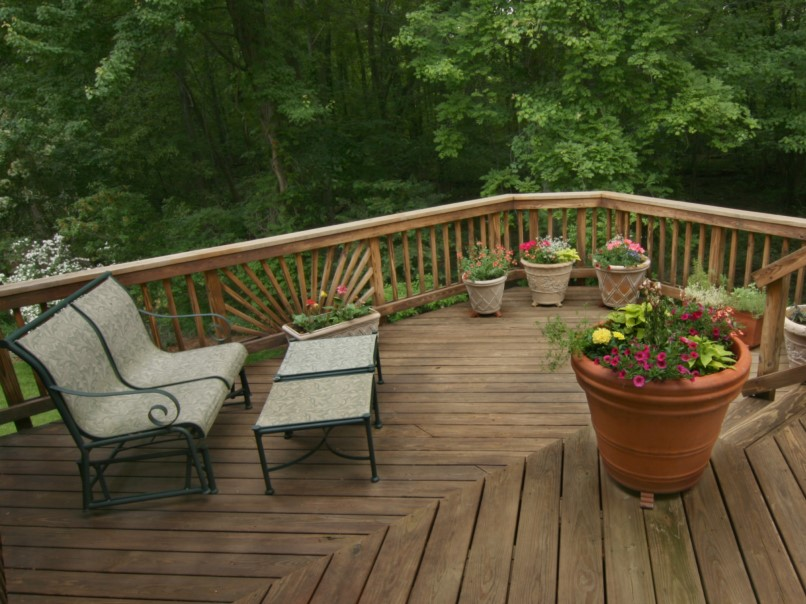 Wood Deck with Container Gardens, ornamental railing